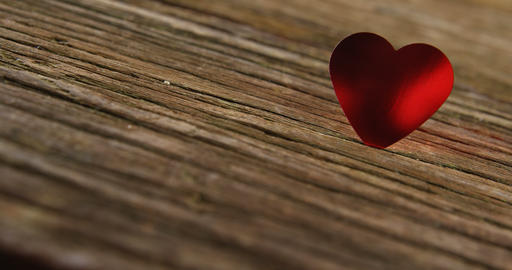Red heart tuck in the wooden plank 4k Live Action