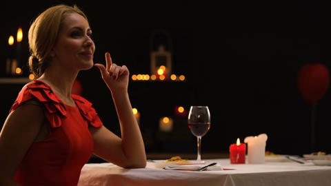 Beautiful lady happy to see boyfriend with bunch of roses, dinner in restaurant Live Action