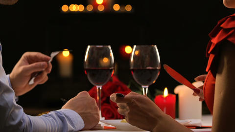 Elegant couple dining in restaurant, clinking glasses celebrating Valentines day Live Action