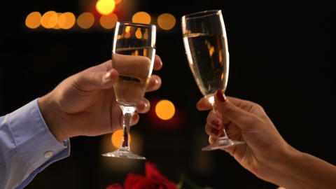 Woman and man clinking glasses with champagne, romantic date, fest celebration Footage