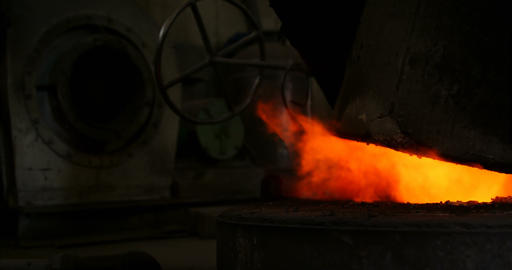 Melting metal being heated in workshop 4k Live Action