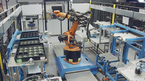Robot working in an electronics manufacturing facility Live Action