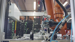 Robot working in an electronics manufacturing facility, Live Action