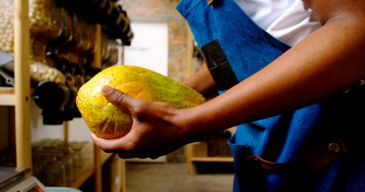 Male staff weighing papaya on weighing machine 4k Live Action