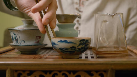 Hand tea master pour our first infusion green tea while chinese tea ceremony Live Action