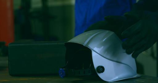 Robotic engineer wearing welding helmet in warehouse 4k Live Action