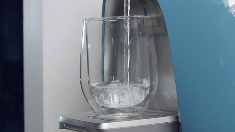 Slow motion of a water cup filling in a water filtering machine Footage