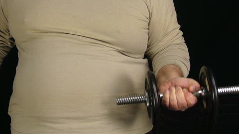 Fat Man Working Out With Tiny Dumbbell Footage