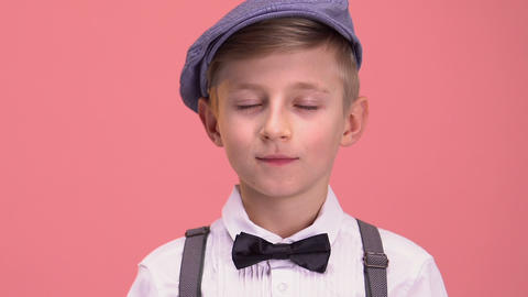Smart boy in retro clothes looking into camera, isolated… Stock Video Footage