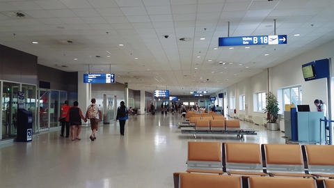 Athens, Greece airport gates waiting area with passengers Live Action