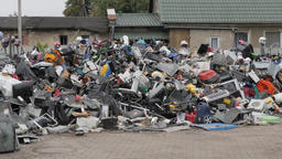 Unsorted plastic waste and old household appliances. Recycling center Footage