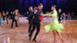 Slow motion of anonymous defocused people dancing latin dances. Ballroom dancing Archivo