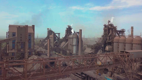 Blast furnace view from the air. Old factory. Aerial view over industrialized Footage