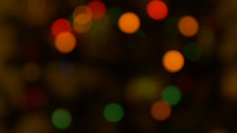 Blurred Christmas lights Bokeh, low loght tone. Copy space for creative design Footage