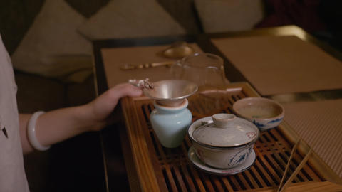 Tea ceremony. Japanese tea cup. Oolong tea. profile view. Tea ceremony. Organic Live Action