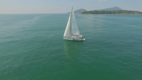 Yacht sailing on open sea at sunny day. Yachting. Yacht video. Yacht drone video Footage