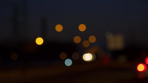 Timelapse of blurry bokeh lights, driving in town traffic Live Action