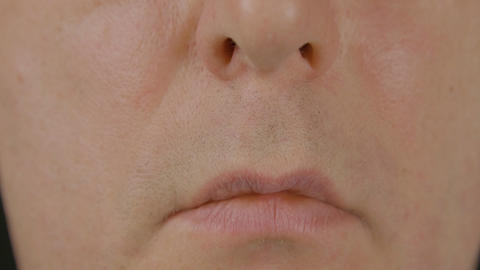 Close up male mouth, lips and nose. Clean shaven male face. Part human face Live Action