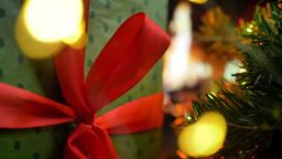 Put a gift on the table. Christmas three on glow fireplace bokeh lights Archivo