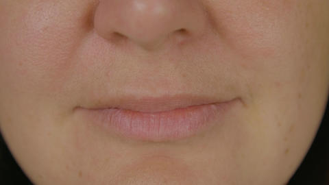 Female face showing kiss lips and smiling close up. Expression facial emotions Live Action