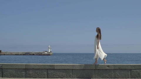Barefooted Woman Walking On The Pier Footage