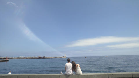 Young Couple Hugging On A Pier Footage