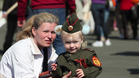 family mother and her child in military uniform Footage