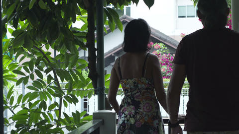 happy couple in love on the balcony of their hotel Footage