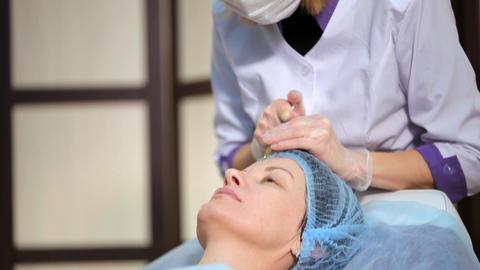Face massaged by an expert masseuse in a wellness center Footage