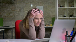 Closeup portrait of emotional female office worker typing on the laptop and Footage
