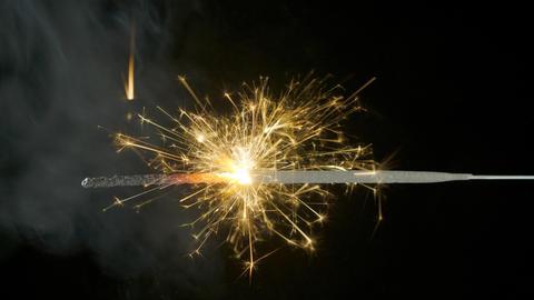 Bengal fire on the dark black background, Christmas sparkler Footage