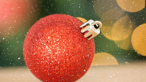 Falling snow and Christmas bauble Animation