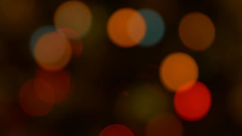 Christmas light leaks flashing on decorative garland, blur and bokeh effect Live Action
