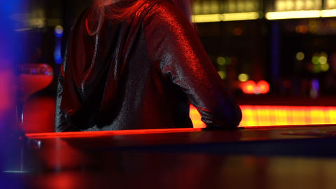 Handsome young man passionately kissing girlfriend in bar, clubbing night life Live Action