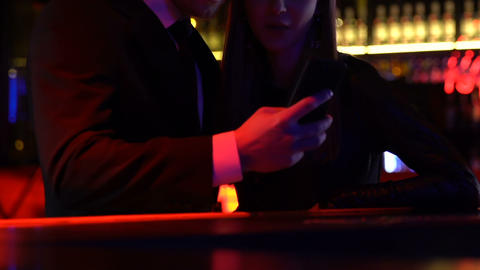 Loving couple taking selfie in night club, weekend leisure, clubbing youth Live Action