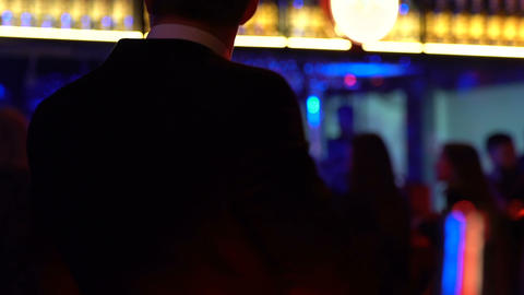 Young clubber dancing at disco party with glass of alcohol, night lifestyle Footage