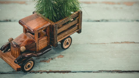 Model car with a fir on its roof combined with falling snow Animation