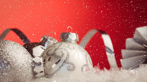 Falling snow with Christmas baubles decoration Animation