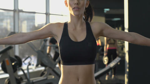 Concentrated woman doing jumping exercise, fitness in morning, healthy lifestyle Live Action
