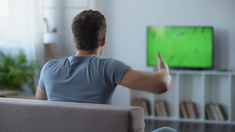 Football supporter actively cheering his favourite team, disappointed with game Footage