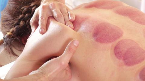 Massage shoulders of girl Live Action
