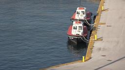 Greece Athens Piraeus harbor two pilot boats at pier of port Archivo