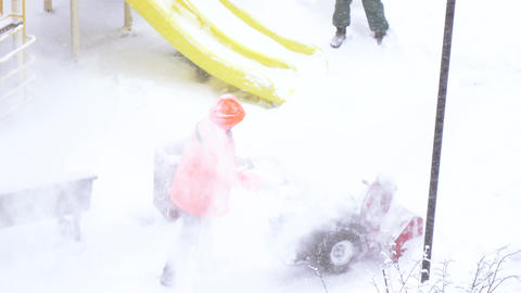 Snow cleaning with snow removal machine Live Action