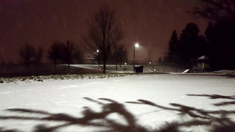 Snowy Night in the Park Along Playground. Beautiful Evening Snowing View. Night Live Action