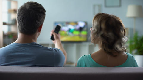 Couple arguing over watching tv, man and woman having conflict, relationship Live Action