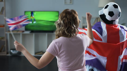 British fans watching football match on tv at home, supporting national team Footage