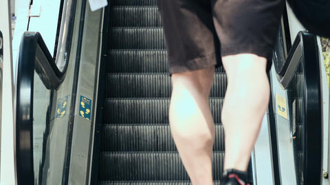 man comes to moving escalator at the train station Footage