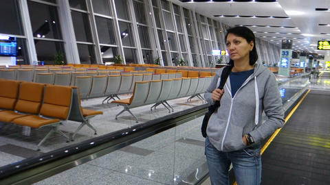 Woman walks at empty hallway Airport Footage