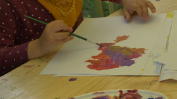 Child Painting with Tempera Paints Footage
