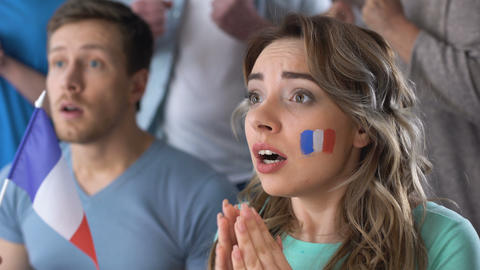 French supporters celebrating victory of national team, watching football match Footage